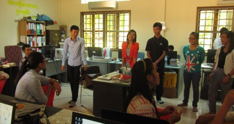 Four Web Essentials' developers sharing ideas with the admin team at an orphanage.