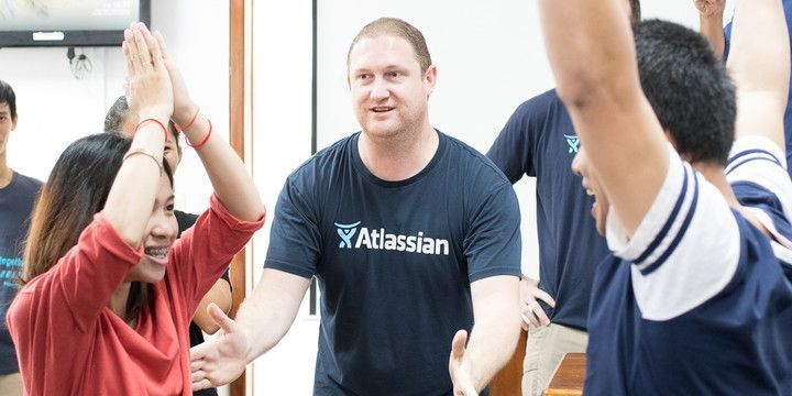 Atlassian staff facilitating ice breakers with Web Essentials team members.