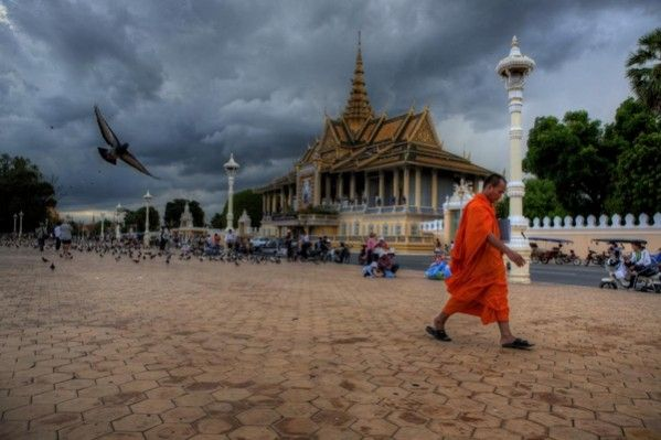 Front image of the First TYPO3 Conference in Asia depicting a monk walking past the Royal Palace in Phnom Penh.