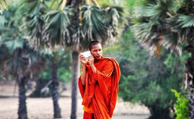 Cambodian monk with cell phone