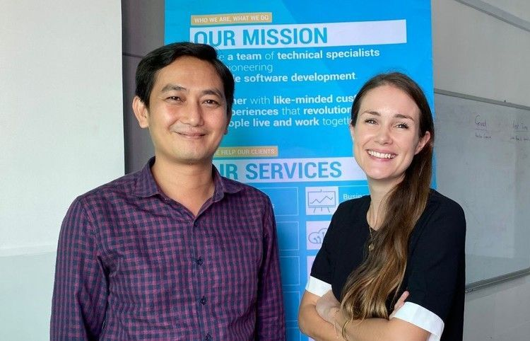 Visay and Amy are standing in front of our ICT4D X- Stand