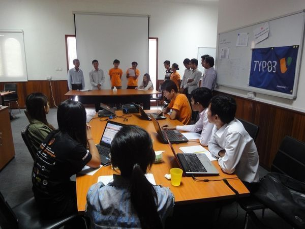 Participants engaging in a presentation during a Cambodian TYPO3 User Group meet up.