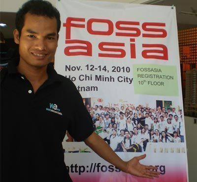 A developer takes a picture in front of the Fossasia X-stand in Ho Chi Minh City.