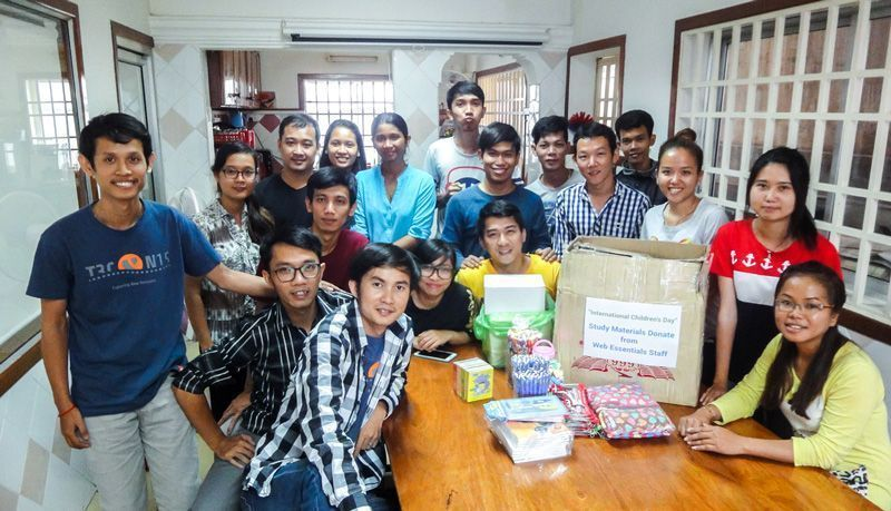 Web Essentials staff group-photo while donating study materials for underpriviliged children on International Children's Day.