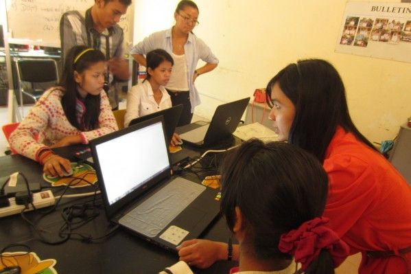 A team of Web Essentials' holding a web development introduction course at an orphanage.