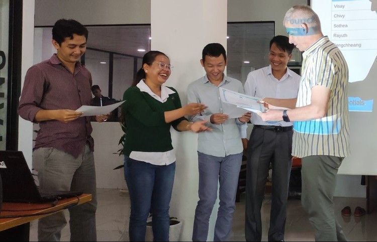 Web Essentials employees receiving shares certificates